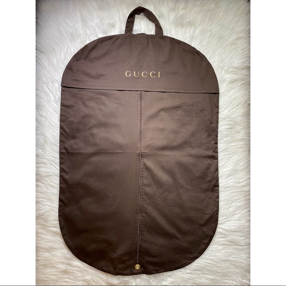 Brown Gucci hanging storage cover